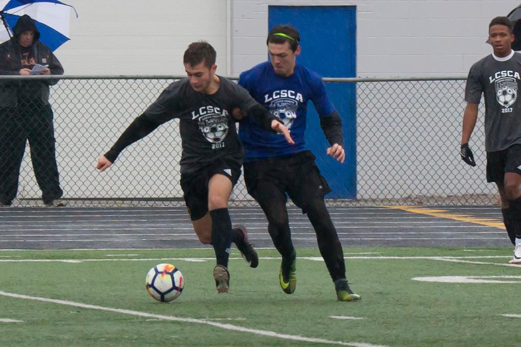 . Avon Lake\'s Jack Lawniczak on the Grey team controls the ball despite a challenge. Jen Forbus -- The Morning Journal