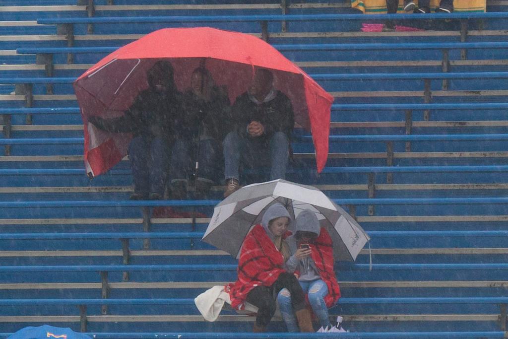 . Die-hard fans brave the rain. Jen Forbus -- The Morning Journal
