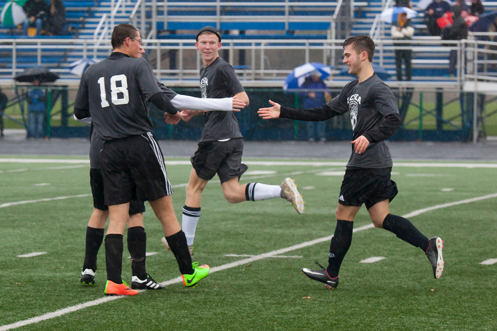 . Jen Forbus -- The Morning Journal  Avon Lake\'s Jack Lawniczak, right, celebrates a goal with his fellow teammates on the All-Star Grey team.