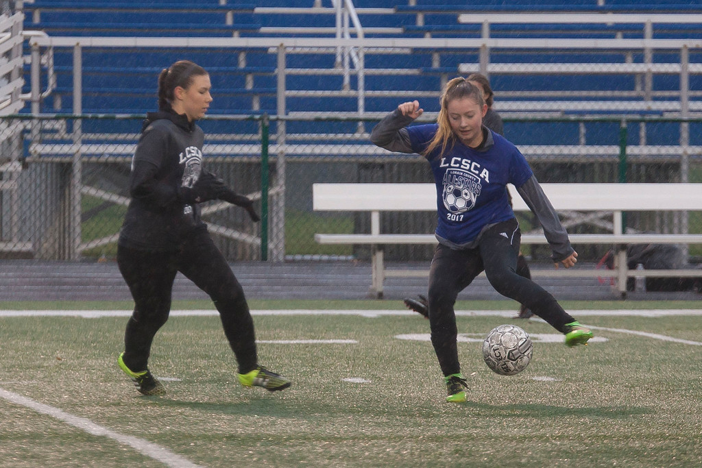 . Columbia\'s Lanie Welker (Blue) shows her ball handling skills as Wellington\'s Victoria Horoschak (Grey) moves in to try and stop her. Jen Forbus -- The Morning Journal