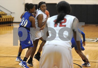 photo by Sarah A. Miller/Tyler Morning Telegraph  Robert E. Lee's Berjae Lewis looks to pass to teammate (12) Dajah Thompson during their game against John Tyler at Tyler Junior College's Wagstaff Gymnasium Tuesday afternoon.