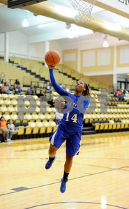 photo by Sarah A. Miller/Tyler Morning Telegraph  John Tyler's Tameal Jones makes a break to the basket during their game against Robert E. Lee at Tyler Junior College's Wagstaff Gymnasium Tuesday afternoon. The John Tyler Lions won, 80-39.