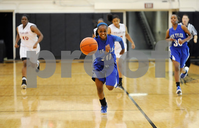 photo by Sarah A. Miller/Tyler Morning Telegraph  John Tyler's Tootie Johnson chases down the ball to their basket during their game against Robert E. Lee at Tyler Junior College's Wagstaff Gymnasium Tuesday afternoon. The John Tyler Lions won, 80-39.