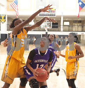 Jacksonville College's Brianna Perry is blocked by Tyler Junior College's (24) Sky'lynn Holmes in their game that went into double overtime Saturday at TJC's Wagstaff Gymnasium.   (Sarah A. Miller/Tyler Morning Telegraph)