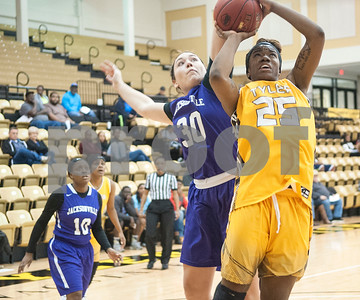 Jacksonville College's (30) Samantha Weir tries to stop  Tyler Junior College's (25) Jasmine Williams in their game that went into double overtime Saturday at TJC's Wagstaff Gymnasium.   (Sarah A. Miller/Tyler Morning Telegraph)