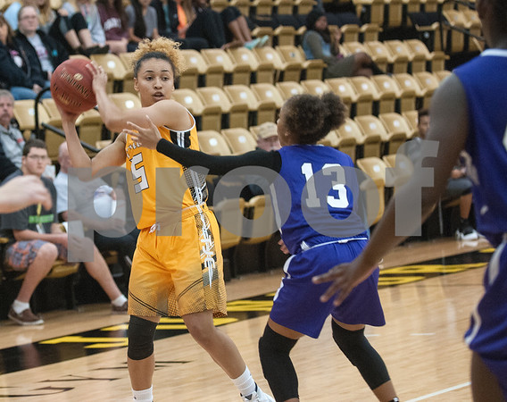 Tyler Junior College's (5) Autumn Avina looks for a pass in their game against Jacksonville College that went into double overtime Saturday at TJC's Wagstaff Gymnasium.   (Sarah A. Miller/Tyler Morning Telegraph)
