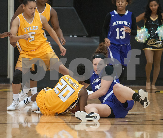 Tyler Junior College's (20) Princess Cole and Jacksonville College's Samantha Weir compete for the ball in the second half of a game that went into double overtime Saturday at TJC's Wagstaff Gymnasium.   (Sarah A. Miller/Tyler Morning Telegraph)