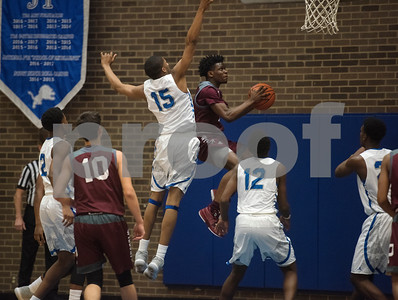 Palestine's (2) Israel Fatade jumps for a basket as they play John Tyler High School during their basketball game against Palestine on Tuesday Nov. 21, 2017.  (Sarah A. Miller/Tyler Morning Telegraph)