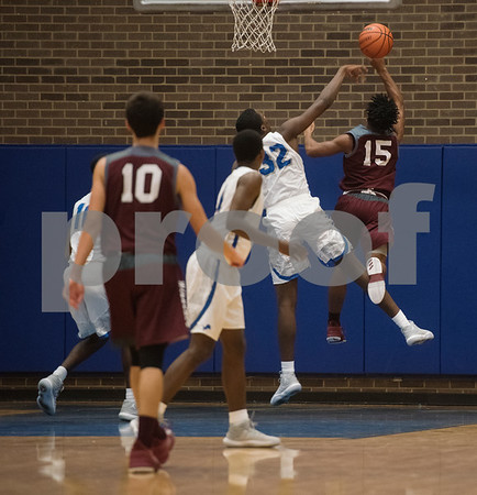 Palestine's (15) shoots for a basket as they play John Tyler High School during their basketball game against Palestine on Tuesday Nov. 21, 2017.  (Sarah A. Miller/Tyler Morning Telegraph)