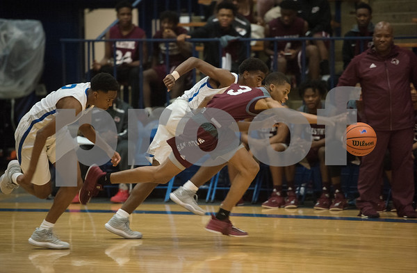Palestine's (3) loses control of the ball as they play John Tyler High School during their basketball game against Palestine on Tuesday Nov. 21, 2017.  (Sarah A. Miller/Tyler Morning Telegraph)