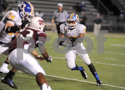 photo by Sarah A. Miller/Tyler Morning Telegraph  Corsicana's (22) senior Ronnie Devearux carries the ball in the second quarter of their game at Whitehouse Friday night.