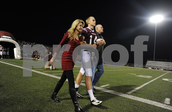 photo by Sarah A. Miller/Tyler Morning Telegraph  Whitehouse's senior Dylan Cantrell is escorted by his parents Shelly and Kenny Cantrell at the start of their game at home Friday night for senior night.