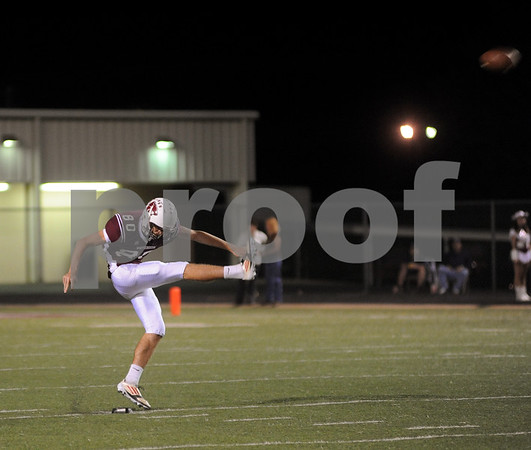 photo by Sarah A. Miller/Tyler Morning Telegraph  Whitehouse's (80) senior kicker Destin Wilkins makes a punt during their game at Whitehouse Friday night.