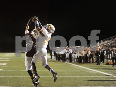 photo by Sarah A. Miller/Tyler Morning Telegraph  Whitehouse's (22) junior Isaiah Burton intercepts the ball in the end zone  from Corsicana's (5) senior Ashton Newsome in the second quarter of their game at Whitehouse Friday night.