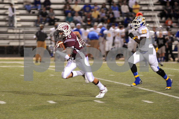 photo by Sarah A. Miller/Tyler Morning Telegraph  Whitehouse's (10) junior Jake Parker carries the ball in their game at Whitehouse Friday night against Corsicana.