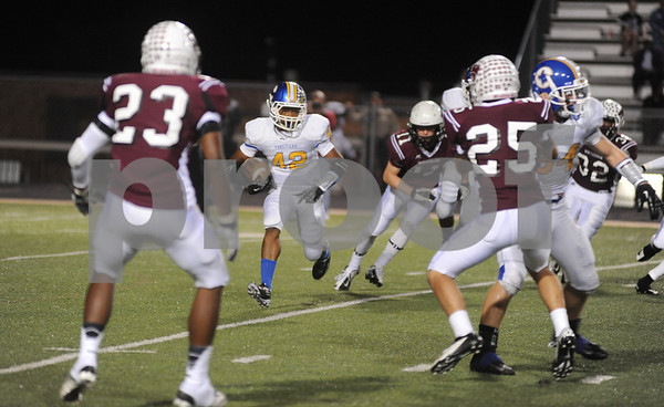 photo by Sarah A. Miller/Tyler Morning Telegraph  Corsicana's (42) freshman Trey Owens carries the ball in the first quarter of their game at Whitehouse Friday night.
