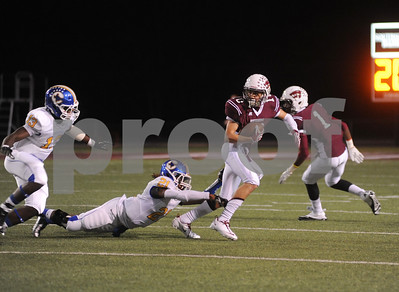 photo by Sarah A. Miller/Tyler Morning Telegraph  Whitehouse's (10) junior Jake Parker is caught up by Corsicana's (21) senior Alonzo Gipsonduring their game at Whitehouse Friday night.