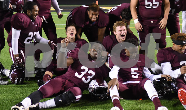 Arp football seniors celebrate their win over Newton Friday Dec. 2, 2016 at Dragon Stadium in Nacogdoches.   (Sarah A. Miller/Tyler Morning Telegraph)