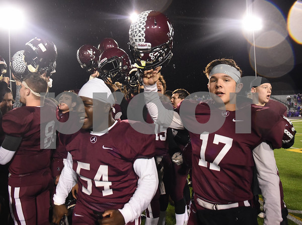 Arp football players celebrate their win over Newton Friday Dec. 2, 2016 at Dragon Stadium in Nacogdoches.   (Sarah A. Miller/Tyler Morning Telegraph)