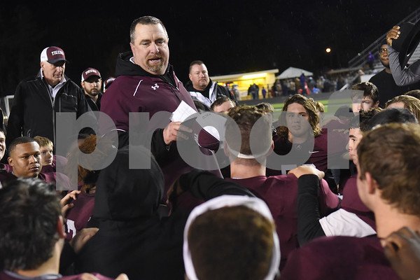 Arp football coach Dale Irwin addresses his players after  their win over Newton Friday Dec. 2, 2016 at Dragon Stadium in Nacogdoches.   (Sarah A. Miller/Tyler Morning Telegraph)