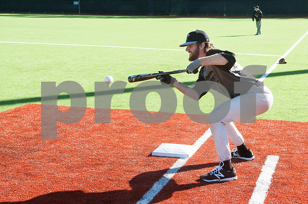Tyler Junior College baseball player Luke Boyd bunts the ball on the brand new turf at Mike Carter Field Tuesday Jan. 12, 2016. The baseball team started their first season practices this week.   (Sarah A. Miller/Tyler Morning Telegraph)
