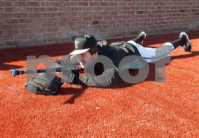 Tyler Junior College baseball player Nathan Methvin lies down with his bat and glove on the new turf at Mike Carter Field before practice Tuesday Jan. 12, 2016. The baseball team started their first season practices this week.   (Sarah A. Miller/Tyler Morning Telegraph)