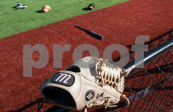 A baseball glove rests on the fence as the Tyler Junior College baseball team uses the brand new turf at Mike Carter Field Tuesday Jan. 12, 2016. The baseball team started their first season practices this week.   (Sarah A. Miller/Tyler Morning Telegraph)
