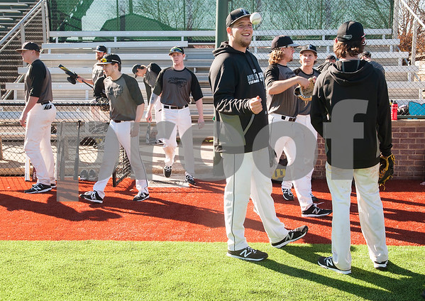 Tyler Junior College baseball player Travis Smith tosses a baseball before starting practice on the new turf at Mike Carter Field Tuesday Jan. 12, 2016. The baseball team started their first season practices this week.   (Sarah A. Miller/Tyler Morning Telegraph)