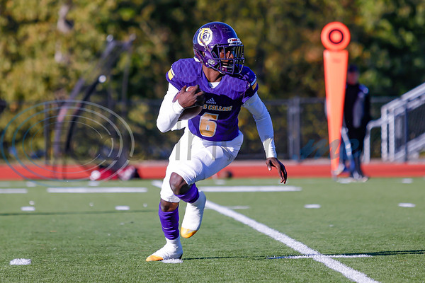 Texas College QB #^ Derrick Copper scrambles.  At Mewbourne Field in Tyler Texas.  photo by John Murphy