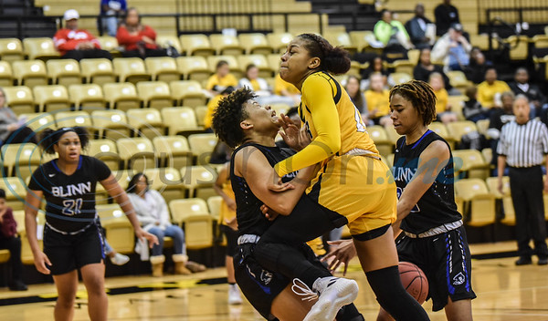Kennedy Burks (20) of Tyler Junior College collides with Armani Anderson (11) of Blinn College during a game hosted by Tyler Junior College on Saturday, January 12. The Lady Apaches went on to win 71-49. (Jessica T. Payne/Tyler Morning Telegraph)