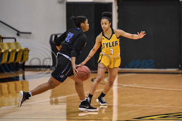 Apache Diamond Atchinson (3) guards Buccaneer Alexus Brigham (32) at Wagstaff Gymnasium on Saturday, January 12. Tyler Junior College hosted Blinn College and went on to win 71-49. (Jessica T. Payne/Tyler Morning Telegraph)