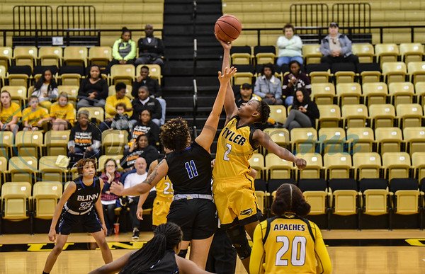 Apache's Felmas Koranga (2) out jumps Buccaneer's Armani Anderson (11) during tip off at Wagstaff Gymnasium. The Tyler Junior College women's basketball team hosted Blinn College on Saturday, January 12. (Jessica T. Payne/Tyler Morning Telegraph)