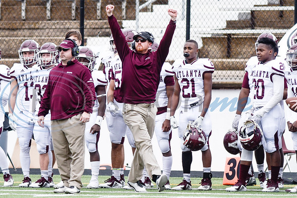 An Atlanta coach raises his fists in the air after Atlanta made a good play during a high school football playoff game at Christus Trinity Mother Frances Rose Stadium in Tyler, Texas, on Friday, Nov. 23, 2018. (Chelsea Purgahn/Tyler Morning Telegraph)