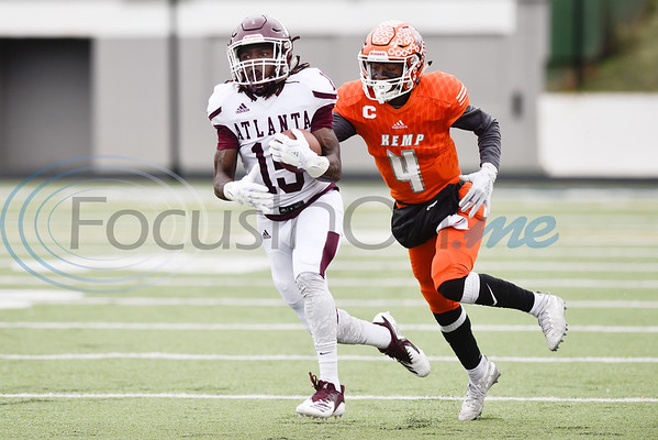 Atlanta wide receiver Joshua Edwards (15) runs the ball as Kemp defensive back Jaise Bowie (4) runs after him during a high school football playoff game at Christus Trinity Mother Frances Rose Stadium in Tyler, Texas, on Friday, Nov. 23, 2018. (Chelsea Purgahn/Tyler Morning Telegraph)