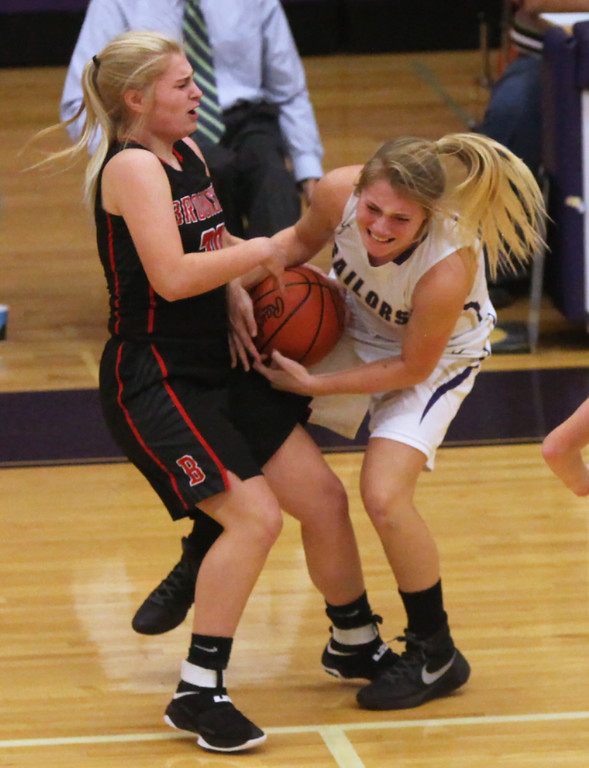 . Brookside\'s Hanna Begany and Vermilion\'s Cece Dillion wrestle for the ball near midcourt during the second quarter. Randy Meyers -- The Morning Journal