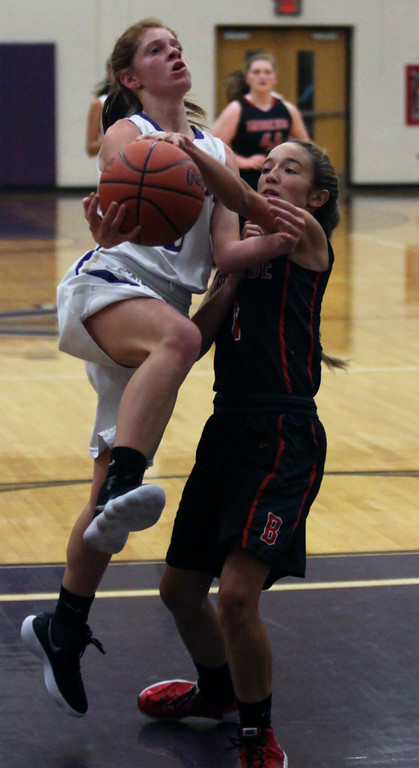 . Shelby Dowdell of Broookside blocks the shot by Clara Smith of Vermilion during the first quarter. Randy Meyers -- The Morning Journal