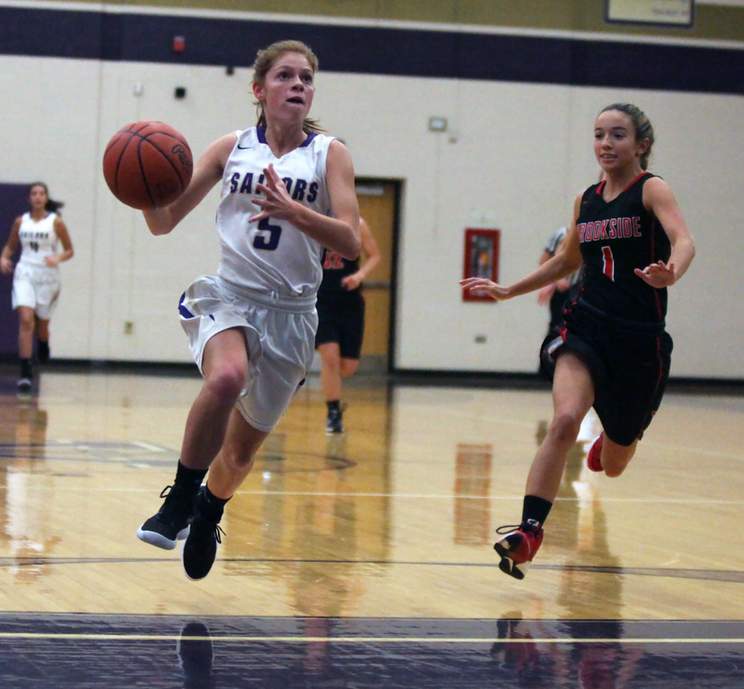 . Vermilion\'s Clara Smith drives and scores on a fast break as Brookside\'s Shelby Dowdell trails on the play during the first quarter. Randy Meyers -- The Morning Journal