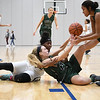 Strongsville's Ashley Peters (12) fights for a loose ball with Lorain guard Rose Carter (23). Eric Bonzar — The Morning Journal
