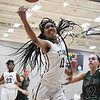 Lorain's Malaya Simmons (11) fights for a rebound. Eric Bonzar — The Morning Journal