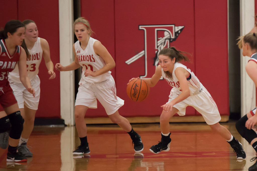 . The Warriors\' Rachel Coyne  makes for the other end of the court when she regains possession of the basketball.Jen Forbus -- The Morning Journal