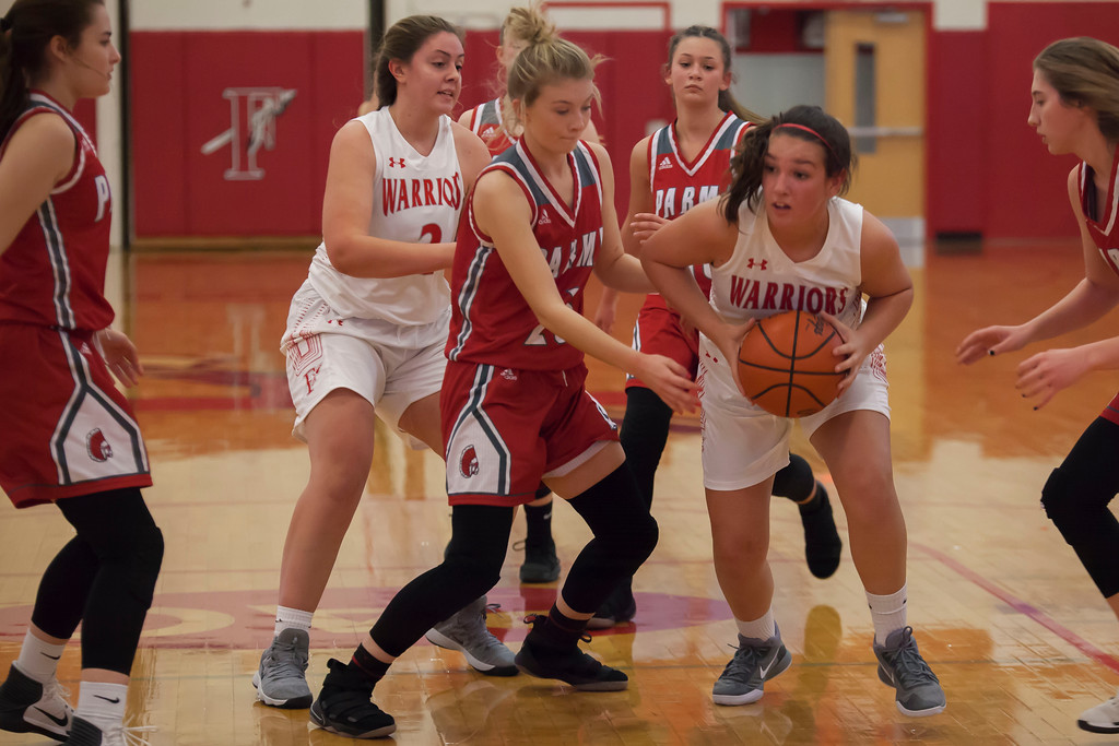 . Fairview\'s Gabby Biggs looks for help as Parma\'s Shannon Chamberlin (23) blocks her path in the key. Jen Forbus -- The Morning Journal