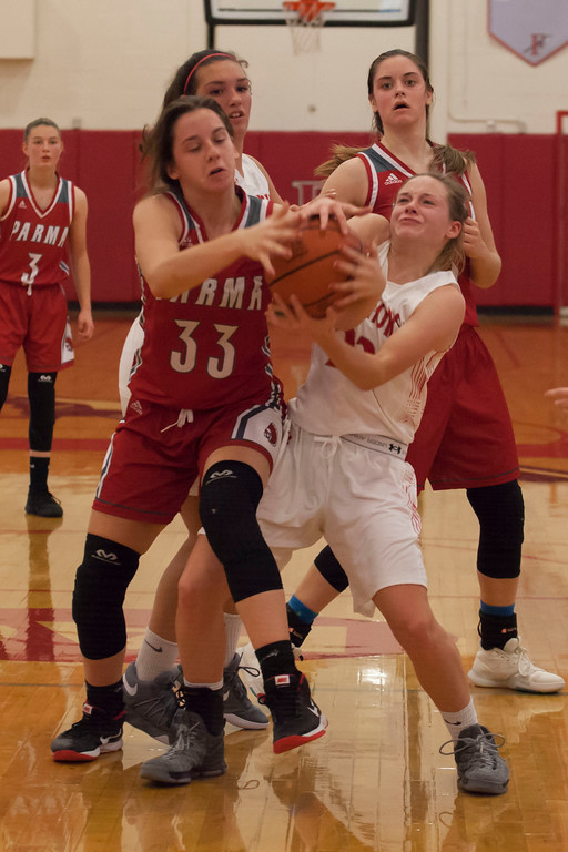 . All hands on the ball as Parma\'s Grace Jacobs and Fairview\'s Lauren Malloy  wrestle for possession. Jen Forbus -- The Morning Journal