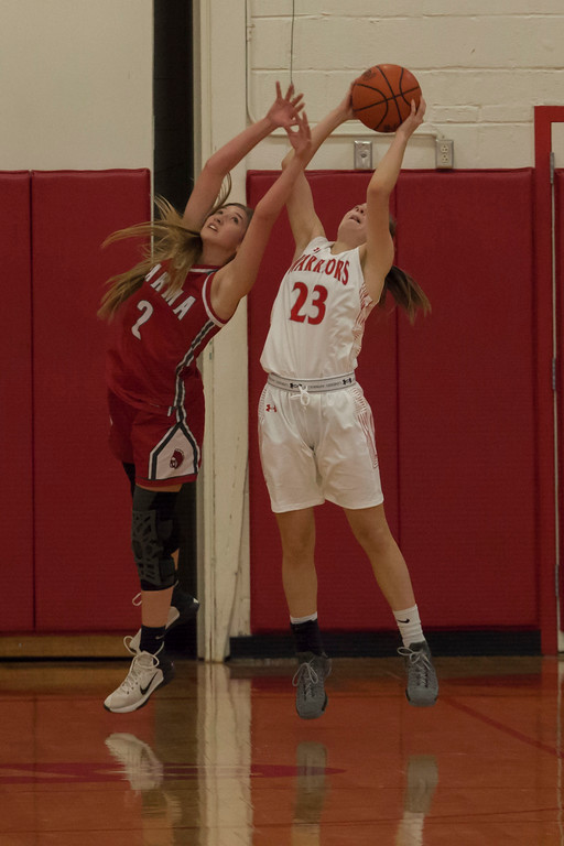 . Parma\'s Mary Chulock tries to stop a shot from Fairview\'s Lauren Malloy. Jen Forbus -- The Morning Journal