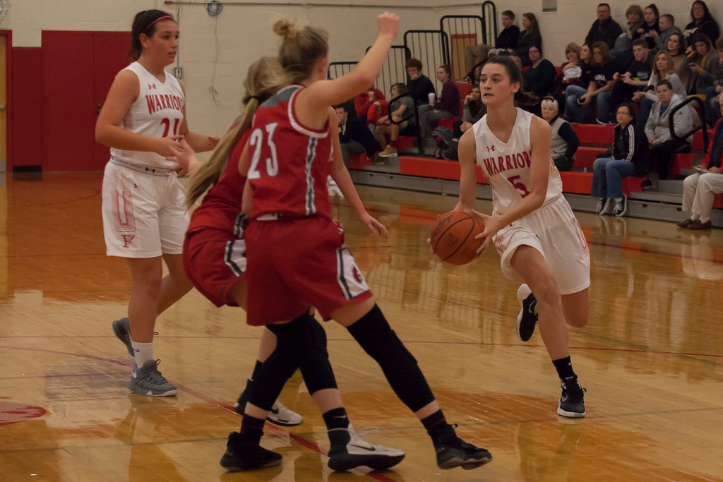 . Fairview\'\'s Julia Costas sees nothing but red as Parma\'s Shannon Chamberlin (23) and Mary Chulock (2) block her way. Jen Forbus -- The Morning Journal