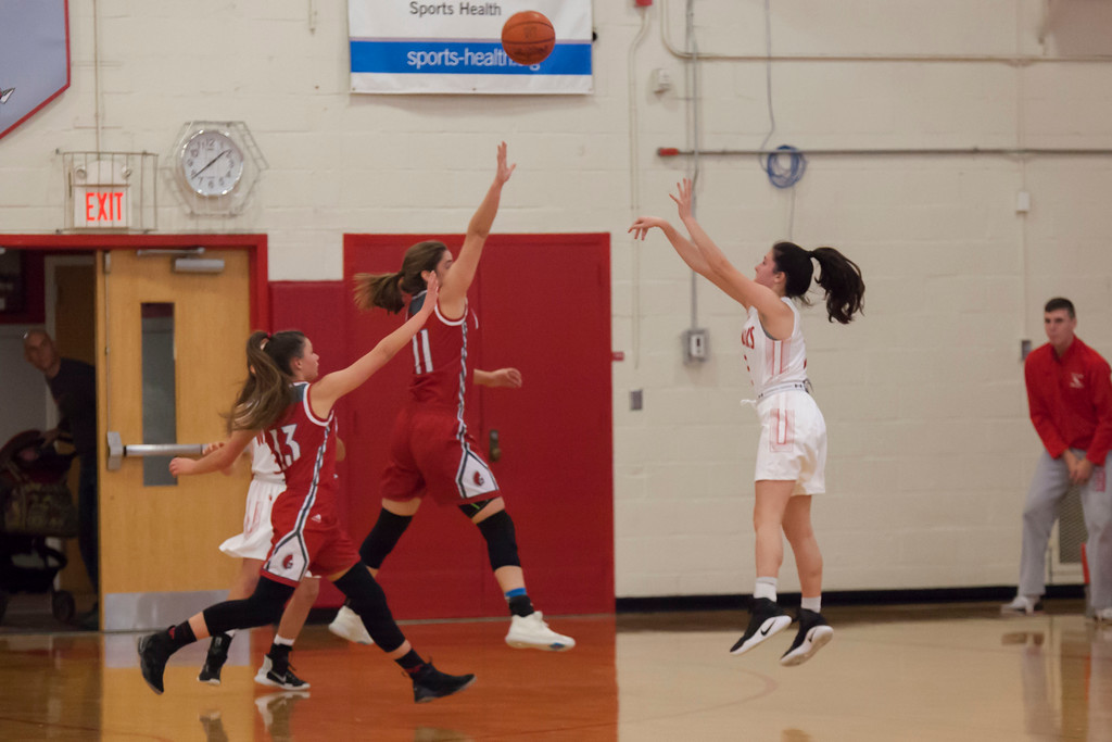 . Fairview\'s Lindsey Hill takes a shot as Parma\'s Lindsay Humbel (11) and Elise Balcer (13) play defense. Jen Forbus -- The Morning Journal