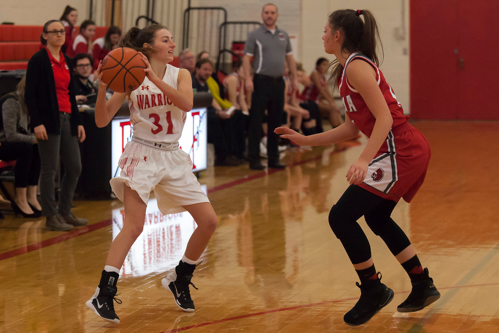 . Fairview\'s Rachel Coyne and Parma\'s Elise Balcer stay on their toes during their season opener. Jen Forbus -- The Morning Journal