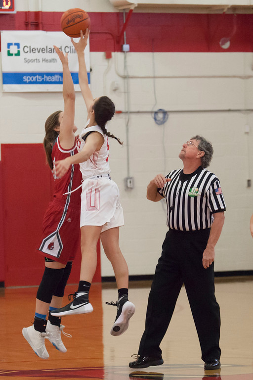 . Fairview\'s Julia Costas and Parma\'s  Lindsay Humbel face off for the jump ball. Jen Forbus -- The Morning Journal
