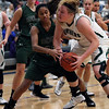 Elyria Catholic's Abby Winnan tries to go up for a shot and is defended by Strongsville's Marnae Holland during the first quarter. Randy Meyers -- The Morning Journal