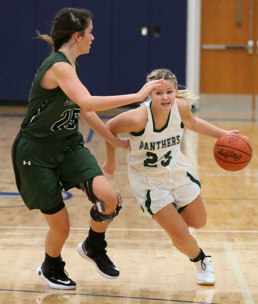 Faith Williams of Elyria Catholic drives around Strongsville's Lindsey Thall during the second quarter. Randy Meyers -- The Morning Journal