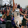 Elyria Catholic's Sam Filiaggi shoots over Brielle Zbydniewski of Strongsville during the second quarter. Randy Meyers -- The Morning Journal